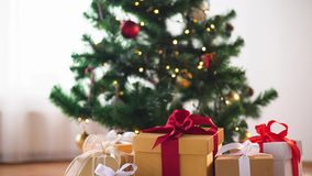 Gift boxes on sheepskin at christmas tree stock footage