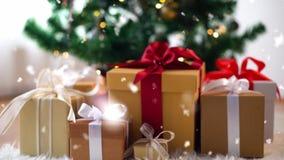 Gift boxes on sheepskin near christmas tree stock footage