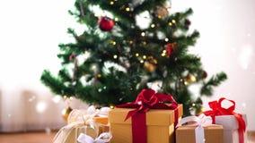 Gift boxes on sheepskin near christmas tree stock video