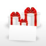 Gift boxes and sheet of paper with a mestome for text Royalty Free Stock Photos