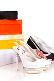 Gift boxes and shoes  on white Royalty Free Stock Image