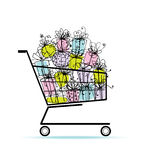 Gift boxes in shopping cart for your design Stock Photography