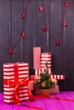 Gift boxes and small decorated Christmas tree Stock Photo