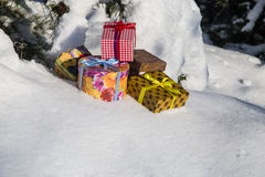 Gift boxes on snow Royalty Free Stock Image