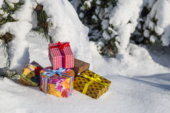 Gift boxes on snow Royalty Free Stock Images