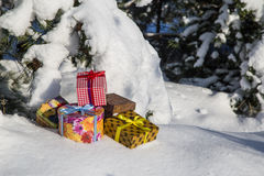 Gift boxes on snow Royalty Free Stock Photos