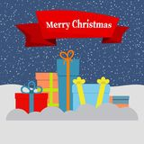 Gift boxes on snow and falling snow and a red ribbon with the inscription Happy Christmas. Vector illustration Royalty Free Stock Photos