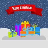 Gift boxes on snow and stellar sky and a red ribbon with the inscription Happy Christmas. Vector illustration Royalty Free Stock Photography