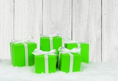 Gift boxes in snow with wood background Stock Photos