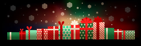Gift boxes and snowflakes Royalty Free Stock Image