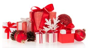 Gift boxes, snowflakes and pine cones Stock Images