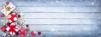 Gift Boxes On Snowy Plank. Christmas Border royalty free stock images