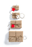 Gift boxes with star shaped paper tag Holidays concep Royalty Free Stock Photo