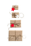 Gift boxes with star shaped paper tag Holidays concep Stock Images