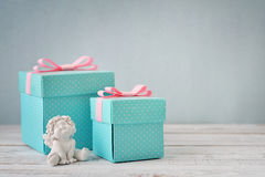 Gift boxes with statuette of angel Stock Photos