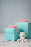 Gift boxes with statuette of angel Royalty Free Stock Photo