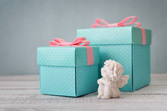 Gift boxes with statuette of angel Stock Image