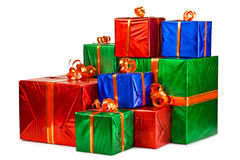 Gift boxes in stock. Pile of gift boxes of various sizes and colors. Isolated on white background Royalty Free Stock Images