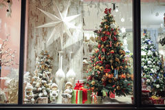 Gift boxes , sweets and christmas decor in shop window. Gift boxes , sweets and christmas decor in the shop window Royalty Free Stock Image