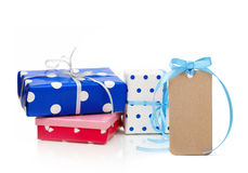 Gift boxes and tag Stock Photos