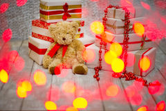 Gift boxes and teddy bear Royalty Free Stock Photos