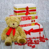 Gift boxes and teddy bear Stock Images