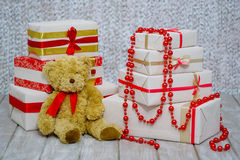 Gift boxes and teddy bear Stock Image