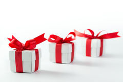 Gift boxes. Three gift boxes with red ribbons on white background Stock Photo
