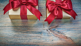 Gift boxes with tied knots on vintage wooden board celebration c. Oncept royalty free stock photography