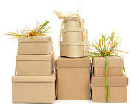 Gift boxes tied with natural raffia of different colors. Some gift boxes tied with natural raffia of different colors on a white background Royalty Free Stock Photo
