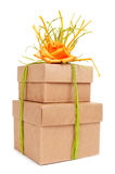 Gift boxes tied with natural raffia of different colors and topp. Some gift boxes tied with natural raffia of different colors and topped with a flower on a Stock Images