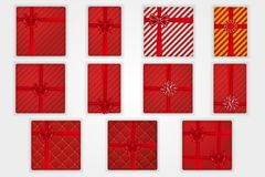 Gift boxes top view set, isolated white background. Red ribbons bow on red giftbox. Decoration element for design. Gift boxes top view set, isolated white vector illustration