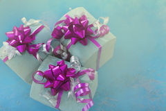 Gift boxes top view. Three gift boxes with bow on pastel texture Royalty Free Stock Image