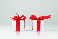 Gift boxes. Two gift boxes with red ribbons on white background Royalty Free Stock Photos