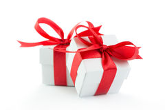 Gift boxes. Two gift boxes with red ribbons on white background Royalty Free Stock Photo