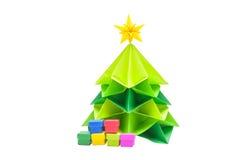 Gift boxes under Chrismas tree. In white background Royalty Free Stock Photo