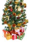 Gift boxes under Christmas tree Stock Photos