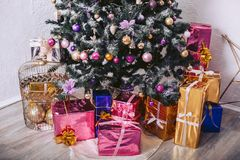 Gift boxes under the New Year tree. Gift boxes under the New Year, green tree Stock Image