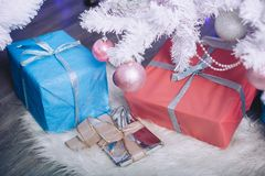 Gift boxes under the New Year tree. In light colors Royalty Free Stock Images
