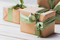 Gift boxes. Vintage gift boxes on wooden background stock images