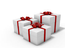 Gift boxes on white background. Boxes tied with red ribbon on white background decorated with bows Stock Image