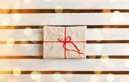 Gift boxes on white wooden background Stock Photos