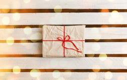 Gift boxes on white wooden background Stock Photos