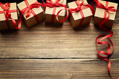 Gift Boxes on Wood Background, Holiday Cardboard Presents Stock Photo
