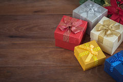 Gift boxes on wooden background Royalty Free Stock Photos