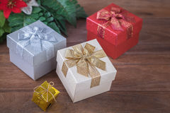 Gift boxes on wooden background Stock Image