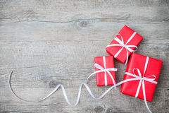 Gift boxes on wooden background Stock Photos