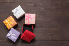 Gift boxes are on the wooden background with empty space Royalty Free Stock Photo