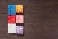 Gift boxes are on the wooden background with empty space Stock Photo