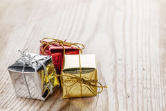 Gift boxes on wooden background Royalty Free Stock Images